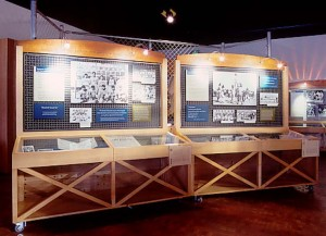Mobile fixtures with artifacts and photos were designed for traveling versions of the exhibit.